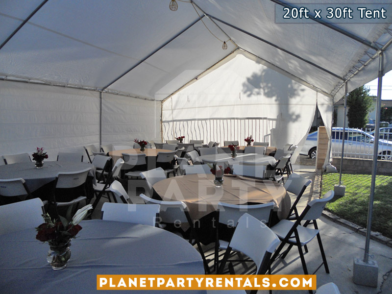 20x30 White Party Tent shown with round tables and plastic chairs