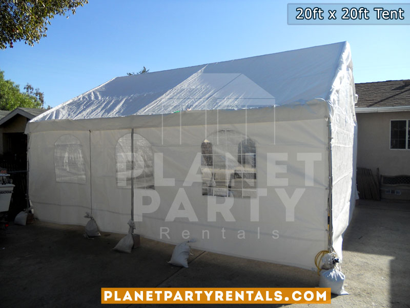 20ft x 20ft white party tent with sidewalls rectangular table and plastic white chairs