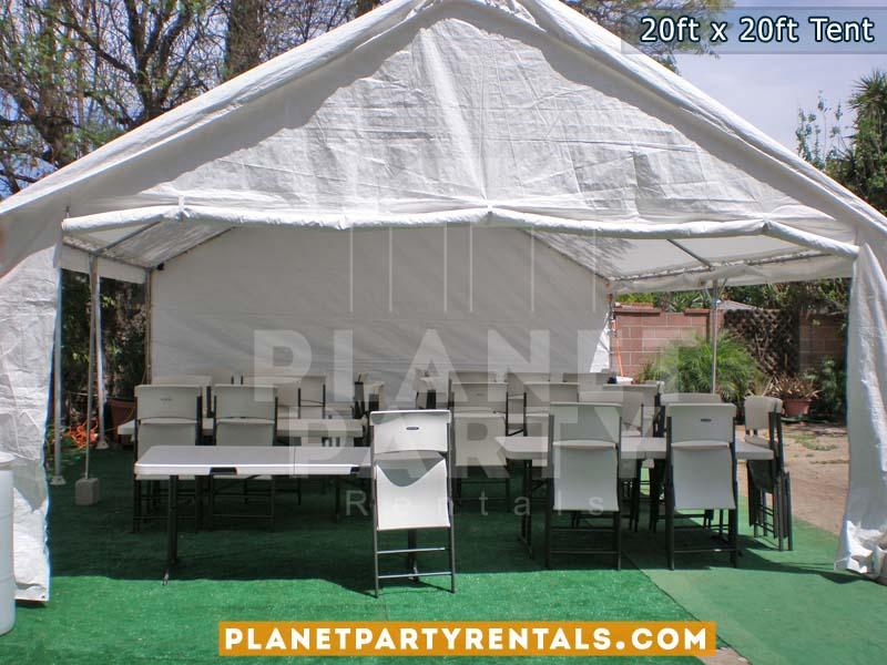 20x20 White Party Tent shown with rectangular tables and plastic chairs