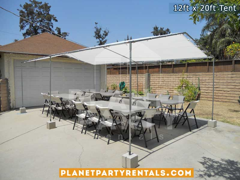 12ft x 20ft white party tent with white rectangular tables and white plastic chairs