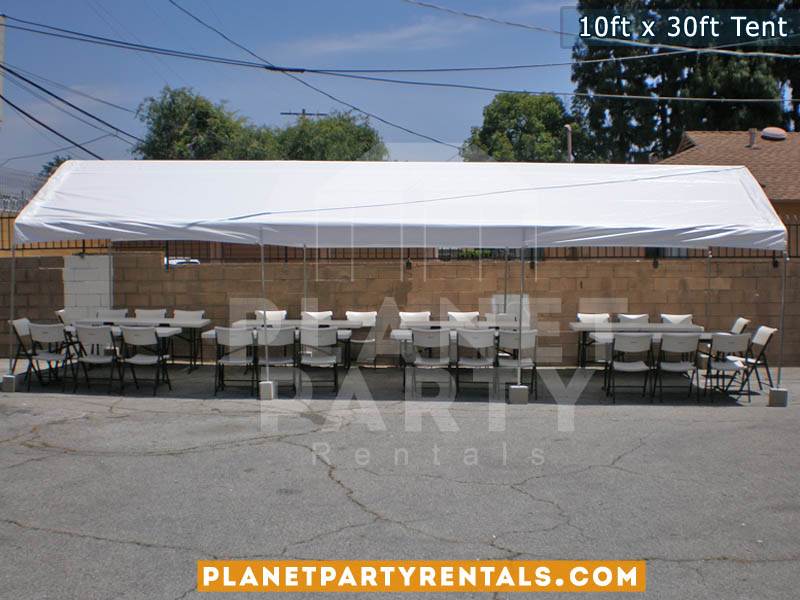 10ft x 30ft Party Tent shown with rectangular tables and plastic white chairs