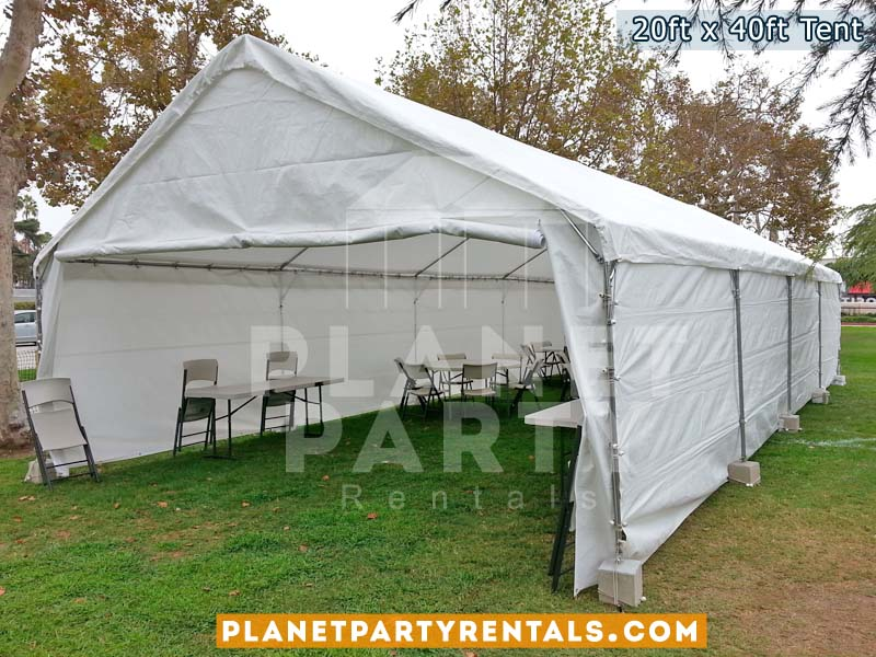 20x40 Tent fully enclosed with all sidepanels setup on grass. Also pictures are plastic chairs and rectangular tables.