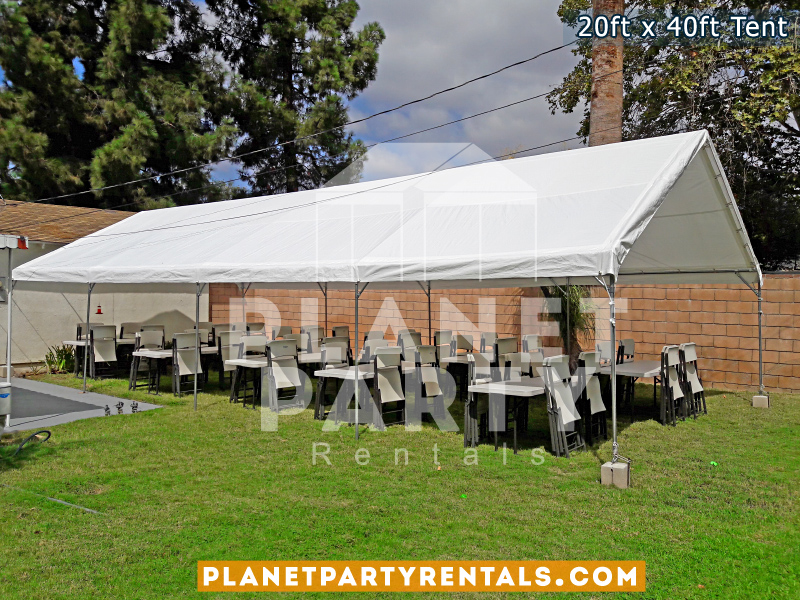 20x40 Tent with no sidepanels setup on grass. Also pictures are plastic chairs and rectangular tables
