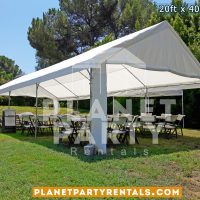 20x40 Tent with partial sidepanels setup on grass. Also shown are round tables and plastic chairs