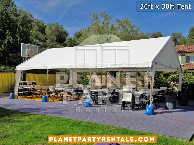 20x30 Tent setup on a basketball court. Also pictures are plastic chairs and rectangular tables.
